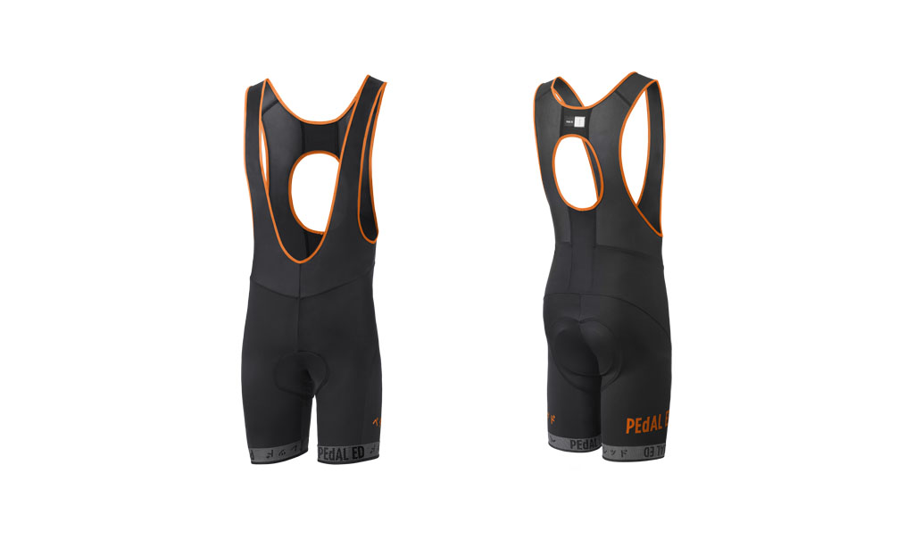 SALOPETTE CICLISMO PEdALED HEIKO BIB SHORTS ORANGE.jpg